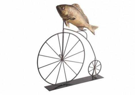 Charlie Fish riding a metal high wheel bicycle